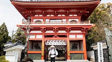 Naruto, Japan - April 2, 2018: Pilgrim at the entrance to Gokurakuji, temple number 2 of Shikoku pilgrimage