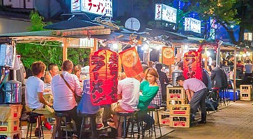 Fukuoka, Japan - June 29, 2014:fukuoka's famous food stalls (yatai) located along the river on Nakasu Island
