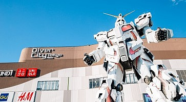 Tokyo, Japan - November 23, 2018 : Odaiba Diver City Tokyo Plaza shopping mall and real-size Gundam robot