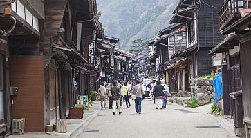 TAKAYAMA, JAPAN - MAY 03: Unidentified people at Sannomachi Street, the old town area which has museums and old private houses, some survive from Edo period on May 03, 2014 in Takayama, Japan.