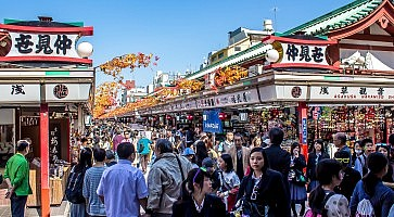 TOKYO, JAPAN - OCTOBER 09, 2015: crowds of tourists at Nakamise-dori, the street with shops at Senso-Ji temple in Tokyo.