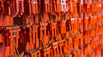 Small torii with prayers and wishes at Fushimi Inari Shrine