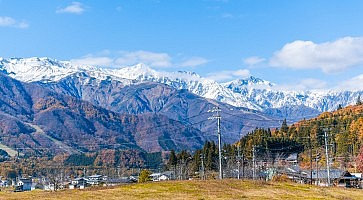 Beautiful landscape view of  Hakuba in the winter with snow on the mountain and blue sky background in Nagano Prefecture Japan.